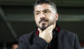FILE - In this Dec. 7, 2017 file photo, AC Milan head coach Gennaro Gattuso looks from the bench ahead of the group D Europa League soccer match between Rijeka and AC Milan, at the Rujevica stadium in Rijeka, Croatia. The bearded Gattuso is getting compliments as a coach as his rejuvenated Milan side has climbed up to seventh in the table, sparking talk it could still sneak into the Champions League. (AP Photo/Darko Bandic, files)