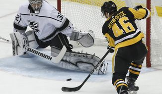 Pittsburgh Penguins' Zach Aston-Reese (46) can't get a shot past Los Angeles Kings goaltender Jonathan Quick (32) during the first period of an NHL hockey game in Pittsburgh, Thursday, Feb. 15, 2018. (AP Photo/Gene J. Puskar)