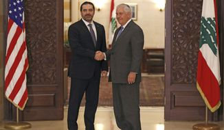 Lebanese Prime Minister Saad Hariri, left, shakes hands with U.S. Secretary of State Rex Tillerson, at the Government House, in Beirut, Lebanon, Thursday, Feb. 15, 2018. Tillerson held talks with the Lebanese president and other officials amid a growing dispute between the small Mediterranean country and neighboring Israel over oil and gas reserves, and Israel's construction of a border wall that Lebanon says encroaches on its territory. (AP Photo/Hussein Malla)