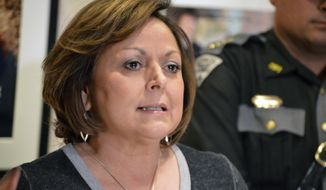 New Mexico Gov. Susana Martinez, a Republican, speaks to reporters outside her office in Santa Fe, N.M. on Thursday, Feb. 15, 2018. The New Mexico Legislature wrapped up a 30-day session Thursday, after approving a $6.3 billion budget bill that shores up spending on the criminal justice system and public education with pay raises allotted to teachers and state workers. (AP Photo/ Russell Contreras)