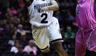Mississippi State guard Morgan William (2) sends a leaping pass to a teammate against Vanderbilt in the first half of an NCAA college basketball game Thursday, Feb. 15, 2018, in Nashville, Tenn. (AP Photo/Sanford Myers)