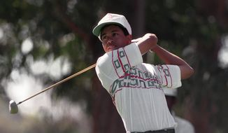 FILE - In this Feb. 26, 1992, file photo, amateur Tiger Woods tees off at the 11th hole during the pro-m for the Los Angeles Open golf tournament at Riviera Country Club in Los Angeles. Woods made his PGA Tour debut at Riviera when he was a 16-year-old junior in high school. Woods is playing the Genesis Open, his first time at Riviera in 12 years. (AP Photo/Bob Galbraith, File)
