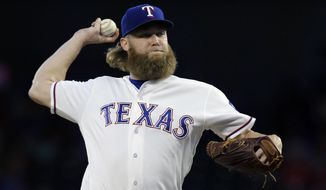 FILE - In this  Saturday, Sept. 30, 2017 file photo, Texas Rangers starting pitcher Andrew Cashner throws during the first inning of a baseball game against the Oakland Athletics in Arlington, Texas.  A person familiar with the negotiations tell The Associated Press that pitcher Andrew Cashner and the Baltimore Orioles have agreed to a $16 million, two-year contract. Cashner is a 31-year-old right-hander. He is 42-64 with a 3.80 ERA in eight major league seasons with the Chicago Cubs, San Diego, Miami and Texas, including 11-11 with a 3.40 ERA for the Rangers last year. (AP Photo/LM Otero, File)