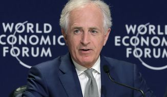 FILE - In this Jan. 24, 2018, file photo, Sen Bob Corker, R-Tenn., speaks at a news conference at the World Economic Forum in Davos, Switzerland. Corker says he will no longer block Persian Gulf nations from buying American-made lethal weapons even though the diplomatic crisis between Qatar and its neighbors remains in a stalemate.. (AP Photo/Markus Schreiber, File)