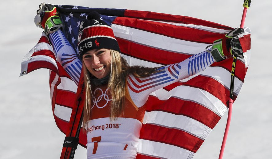 Mikaela Shiffrin, of the United States, celebrate her gold medal during the venue ceremony at the Women's Giant Slalom at the 2018 Winter Olympics in Pyeongchang, South Korea, Thursday, Feb. 15, 2018. (AP Photo/Morry Gash)