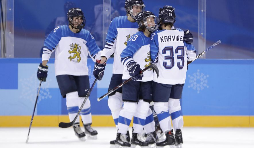 Michelle Karvinen (33), of Finland, is congratulated by teammates, from left, Emma Nuutinen, Rosa Lindstedt and Riikka Valila after scoring a goal on Olympic Athletes from Russia during the first period of a preliminary round women's hockey game at the 2018 Winter Olympics in Gangneung, South Korea, Thursday, Feb. 15, 2018. (AP Photo/Julio Cortez)