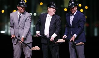FILE--In this Nov. 13, 2017, file photo, Oakland Raiders owner Mark Davis, center, poses beside Nevada Gov. Brian Sandoval, left, and NFL Commissioner Roger Goodell during a ceremonial groundbreaking for the NFL football team's stadium in Las Vegas. Construction work on the stadium has so far exceeded the target for minority and women hiring. (AP Photo/John Locher, file)