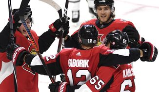 Ottawa Senators' Marian Gaborik (12) celebrates his goal against the Buffalo Sabres with Erik Karlsson (65), Matt Duchene, left, and Mike Hoffman (68) during the third period of an NHL hockey game Thursday, Feb. 15, 2018, in Ottawa, Ontario. (Justin Tang/The Canadian Press via AP)