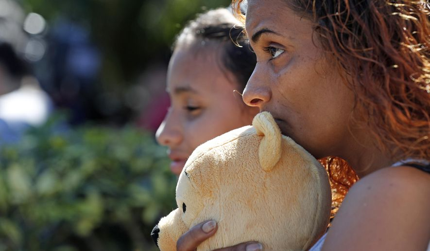 Veronica Laureano attended a vigil Thursday with her daughter Zorayha Laureano, 11, at the Parkland Baptist Church, for the victims of the Wednesday shooting at Marjory Stoneman Douglas High School, in Parkland, Florida. (Associated Press)