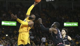 Wichita State center Shaquille Morris shoots over Temple center Ernest Aflakpui during the first half of an NCAA college basketball game Thursday, Feb. 15, 2018, in Wichita, Kan. (Travis Heying/The Wichita Eagle via AP)