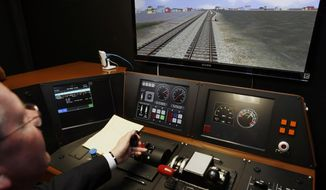 Positive train control offers the prospect of more one-person crews and even self-driving trains, but railroad unions object, claiming that reduced crews put workers and the public at risk. (Associated Press/File)