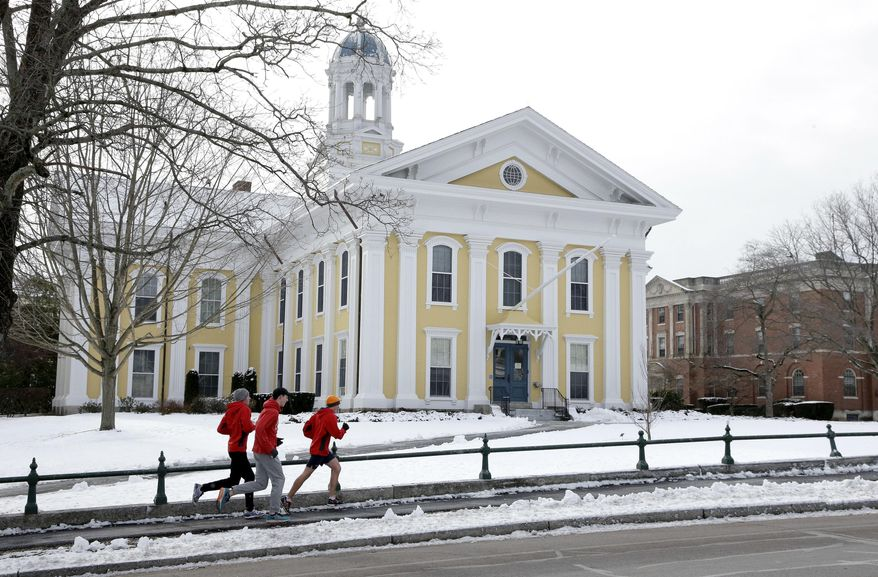 FILE - In this Jan. 14, 2016 file photo, runners make their way along a sidewalk on the campus of Wheaton College in Norton, Mass. Wheaton is getting a $10 million donation in 2018 from the Diana Davis Spencer Foundation, a conservative backer whose namesake is a Wheaton alumna. The gift will create an endowed professorship on social entrepreneurship and new space for existing programs on the topic. (AP Photo/Steven Senne, File)