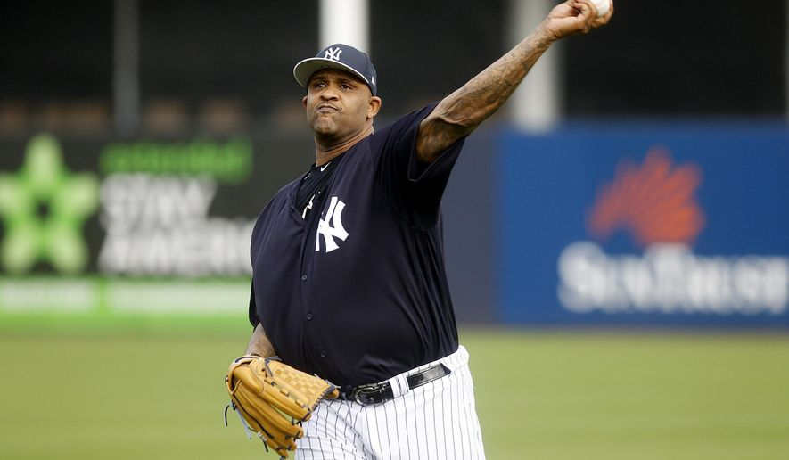 New York Yankees pitcher CC Sabathia throws during baseball spring training at Steinbrenner Field in Tampa, Fla., Tuesday, Feb. 13, 2018. (Octavio Jones/Tampa Bay Times via AP)
