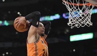 World Team's Dillon Brooks, of the Memphis Grizzlies, dunks during the NBA All-Star Rising Stars basketball game against the U.S. Team, Friday, Feb. 16, 2018, in Los Angeles. (AP Photo/Mark J. Terrill)