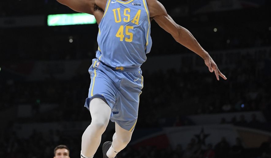 U.S. Team's Donovan Mitchell, of the Utah Jazz, goes up for a dunk as Bogdan Bogdanovic, of the Sacramento Kings, watches during the NBA All-Star Rising Stars basketball game, Friday, Feb. 16, 2018, in Los Angeles. The World Team won 155-124. (AP Photo/Mark J. Terrill)