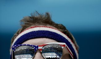 A fan from the United States watches men's curling matches at the 2018 Winter Olympics in Gangneung, South Korea, Friday, Feb. 16, 2018. (AP Photo/Natacha Pisarenko)