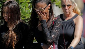 Mourners leave the funeral of Meadow Pollack, a victim of the Wednesday shooting at Marjory Stoneman Douglas High School, in Parkland, Fla., Friday, Feb. 16, 2018. Nikolas Cruz, a former student, was charged with several counts of premeditated murder on Thursday. (AP Photo/Gerald Herbert)