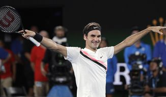 FILE - In this file photo dated Sunday, Jan. 28, 2018, Switzerland's Roger Federer raises his arms after defeating Croatia's Marin Cilic in the men's singles final at the Australian Open tennis championships in Melbourne, Australia. The 36-year-old Federer would become the oldest ever world No. 1, when the new rankings are published upcoming Monday Feb. 19, if he beats leading Dutch player Robin Haase in the ABN AMRO world tennis tournament in Rotterdam.(AP Photo/Dita Alangkara, FILE)