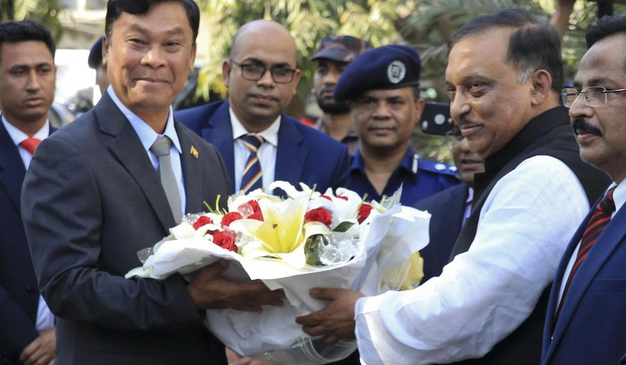 Bangladesh's Home Minister Asaduzzaman Khan, second right, receives Myanmar's Home Minister Kyaw Swe, second left, in Dhaka, Bangladesh, Friday, Feb.16, 2018. Kyaw Swe, on a three-day visit to Bangladesh told Bangladesh's president that Myanmar is ready to take back Rohingya Muslims who fled violence, though Bangladesh said it wanted the hundreds of thousands of refugees to have a safe and dignified return. (AP Photo)