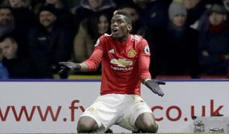 FILE- In this file photo dated Tuesday, Nov. 28, 2017, Manchester United's Paul Pogba reacts during the English Premier League soccer match against Watford at Vicarage Road stadium in Watford, England.  Pogba seems to be experiencing the toughest period of his second spell at Manchester United, Friday Feb. 16, 2018, after he was substituted in two of the last three games and dropped from the other. (AP Photo/Matt Dunham, FILE)
