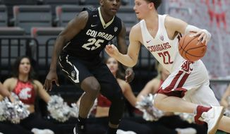 Washington State guard Malachi Flynn (22) drives past Colorado guard McKinley Wright IV (25) during the second half of an NCAA college basketball game Thursday, Feb. 15, 2018, in Pullman, Wash. Washington State won 73-69. (AP Photo/Ted S. Warren)