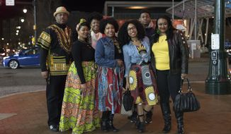 The Lawton family poses for a portrait before seeing Black Panther in Silver Spring, Md., Thursday, Feb. 15, 2018. (AP Photo/Sait Serkan Gurbuz)