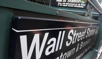 FILE- In this Oct. 2, 2014, file photo, the Wall Street subway stop on Broadway, in New York's Financial District. The U.S. stock market opens at 9:30 a.m. EST on Friday, Feb. 16, 2018. (AP Photo/Richard Drew, File)