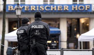 Police guard in front of hotel Bayerischer Hof in Munich, Germany, Friday, Feb. 16, 2018 where the Munich Security Conference will take place from Feb. 16 to Feb. 18, 2018. (Sven Hoppe/dpa via AP)