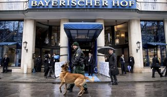 Police patrol in front of hotel Bayerischer Hof in Munich, Germany, Friday, Feb. 16, 2018 where the Munich Security Conference will take place from Feb. 16 to Feb. 18, 2018. (Sven Hoppe/dpa via AP)