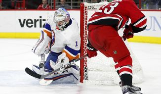 Carolina Hurricanes' Brock McGinn (23) has his shot blocked by New York Islanders goaltender Thomas Greiss (1) during the second period of an NHL hockey game Friday, Feb. 16, 2018, in Raleigh, N.C. (AP Photo/Karl B DeBlaker)