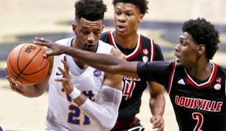 Louisville's Darius Perry (2) steals the ball from Pittsburgh's Terrell Brown (21) during the first half of an NCAA college basketball game, Sunday, Feb. 11, 2018, in Pittsburgh. Louisville won 94-60. (AP Photo/Keith Srakocic)