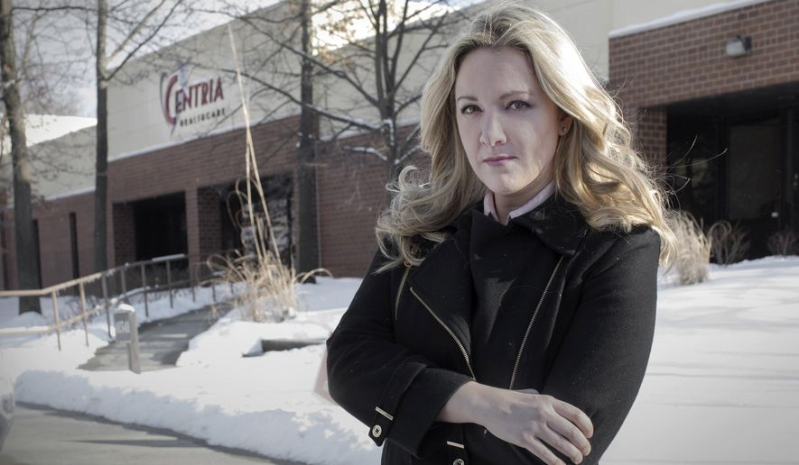 In a Wednesday, Feb. 7, 2018 photo, Vanessa Pawlak, former chief compliance officer for Centria, who was fired from her job after notifying company board members Centria was not in compliance with federal and state laws concerning Medicaid billing, certification of employees and other regulatory issues, is seen outside company offices in Novi, Mich.  (Kathleen Galligan/Detroit Free Press via AP)