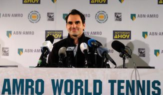 Roger Federer faces the media Friday Feb. 16, 2018, in Rotterdam, Netherlands, after becoming ranked as the world number one player.  Federer added another highlight to his age-defying career resurgence Friday, returning to the top of the world rankings for the first time in more than five years and becoming the oldest player to reach the top spot. (AP Photo/Michael C. Corder)