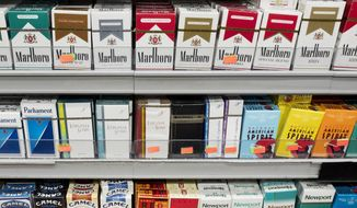 Cigarettes are displayed on a store shelf in New York on Aug. 28, 2017. (Associated Press) **FILE**