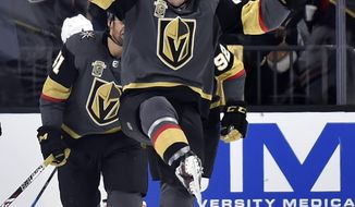 Vegas Golden Knights center Ryan Carpenter (40) reacts after scoring against the Edmonton Oilers during the first period of an NHL hockey game Thursday, Feb. 15, 2018, in Las Vegas. (AP Photo/David Becker)