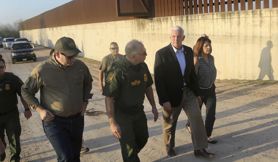 Vice President Mike Pence, second from right, listens to Manuel Padilla, center, U.S. Border Patrol Rio Grande Valley sector chief, while touring the border wall with Sen. Ted Cruz and wife Karen Pence, Friday, Feb. 16, 2018, in Hidalgo, Texas. Pence spent the afternoon touring the U.S.-Mexico border with and talking with federal law enforcement officers on their efforts to secure the border. (Nathan Lambrecht/The Monitor via AP) AP)