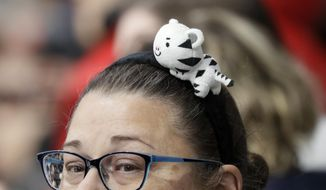 A spectator wears a headband with Soohorang, the mascot of the PyeongChang 2018 Olympic Winter Games, as she watches the men's curling matches at the 2018 Winter Olympics in Gangneung, South Korea, Friday, Feb. 16, 2018. (AP Photo/Aaron Favila)