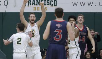 San Francisco's Frankie Ferrari (2), Jimbo Lull (5) and Nate Renfro (15) react after Saint Mary's center Jock Landale, right, fouled out during the second half of an NCAA college basketball game in San Francisco, Thursday, Feb. 15, 2018. (AP Photo/Jeff Chiu)