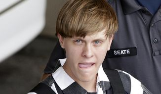 This June 18, 2015, file photo shows Charleston, S.C., shooting suspect Dylann Storm Roof being escorted from the Cleveland County Courthouse in Shelby, N.C. (AP Photo/Chuck Burton, File)
