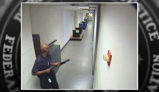 In this Sept. 16, 2013 security camera image provided by the FBI, Navy Yard shooting suspect Aaron Alexis is seen carrying a shotgun through a hallway at the Washington Navy Yard. He's among recent mass shooters who've legally obtained and owned weapons because of limited weapons laws, lapses in the background check process or law enforcement's failure to heed warnings of concerning behavior. (FBI via AP)