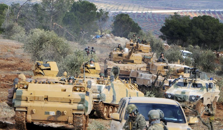This Jan. 28, 2018, file photo, Turkish troops take control of Bursayah hill, which separates the Kurdish-held enclave of Afrin from the Turkey-controlled town of Azaz, Syria. (DHA-Depo Photos via AP, File)