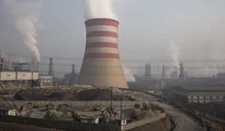 FILE - In this Dec. 30, 2016, file photo, smoke and steam spew from the sprawling complex that is a part of the Jiujiang steel and rolling mills in Qianan in northern China's Hebei province. The Commerce Department is urging President Donald Trump to impose tariffs or quotas on imported aluminum and steel. The recommendations unveiled by Secretary Wilbur Ross on Friday, Feb. 16, 2018, are likely to escalate tensions with China and other U.S. trading partners. (AP Photo/Ng Han Guan, File)