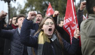 """Demonstrators chant anti-US slogans during a rally near the building where Turkey's Foreign Minister Mevlut Cavusoglu and US Secretary of State Rex Tillerson, in Ankara, Turkey, Friday, Feb. 16, 2018. The group protested U.S. support to Syrian Kurdish militia, known as the People's Protection Units, or YPG_ the top U.S. ally in the fight against the Islamic State. Turkey considers them a """"terrorist"""" group linked to Kurdish rebels fighting inside Turkey. (AP Photo)"""
