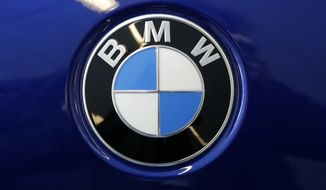 This is a BMW logo on a BMW automobile on display at the Pittsburgh Auto Show Thursday, Feb. 15, 2018. (AP Photo/Gene J. Puskar) **FILE**