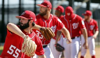 Washington Nationals pitchers, including Tim Collins (55) and Matt Grace (33) throw in the bullpen during spring training baseball practice Saturday, Feb. 17, 2018, in West Palm Beach, Fla. (AP Photo/Jeff Roberson) **File**