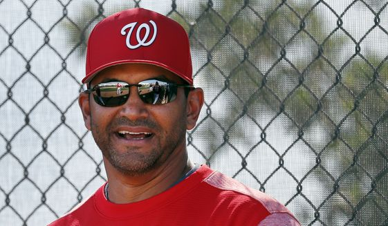 Washington Nationals manager Dave Martinez watches during spring training baseball practice Saturday, Feb. 17, 2018, in West Palm Beach, Fla. (AP Photo/Jeff Roberson) ** FILE **
