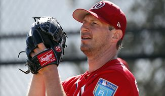 Washington Nationals pitcher Max Scherzer throws a bullpen session during spring training baseball practice Saturday, Feb. 17, 2018, in West Palm Beach, Fla. (AP Photo/Jeff Roberson)