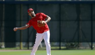 Washington Nationals infielder Anthony Rendon throws during spring training baseball practice Saturday, Feb. 17, 2018, in West Palm Beach, Fla. (AP Photo/Jeff Roberson) **FILE**