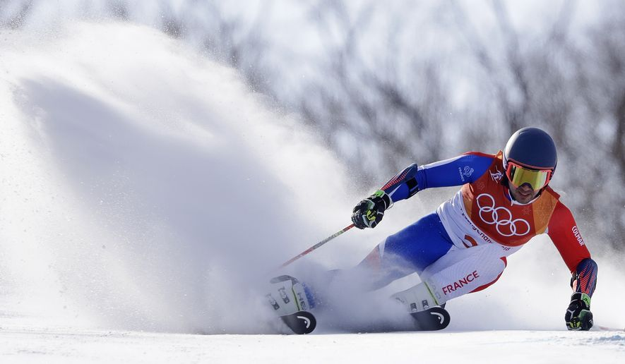 France's Mathieu Faivre competes during the first run of the men's giant slalom at the 2018 Winter Olympics in Pyeongchang, South Korea, Sunday, Feb. 18, 2018. (AP Photo/Luca Bruno)