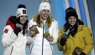Medalists in the women's super-G, from left, Austria's Anna Veith, silver, Czech Republic's Ester Ledecka, gold, and Liechtenstein's Tina Weirather, bronze, pose during their medals ceremony at the 2018 Winter Olympics in Pyeongchang, South Korea, Saturday, Feb. 17, 2018. (AP Photo/Morry Gash)